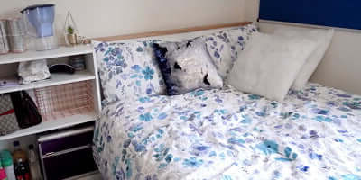 Bed and shelf of a room in Moreton Road accommodation